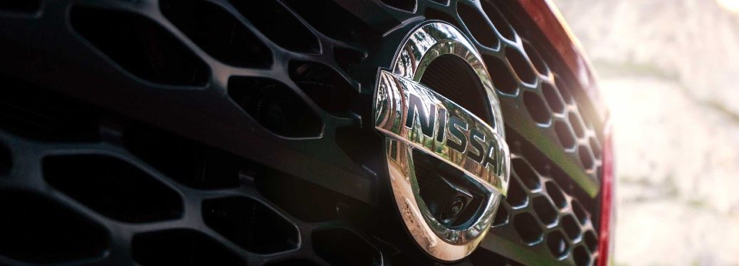 Close up of the Nissan logo on a grille of a Nissan vehicle