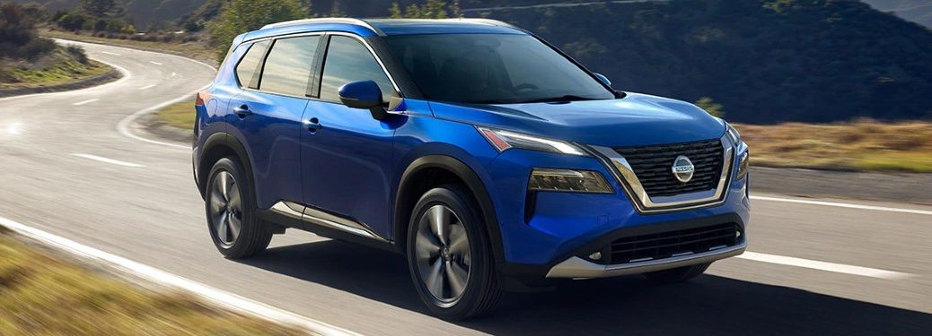 Front passenger angle of a blue 2021 Nissan Rogue