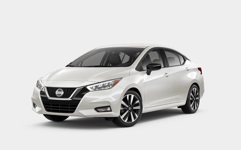 Front driver angle of the 2020 Nissan Versa in Fresh Powder color