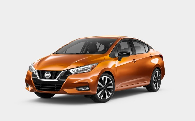 Front driver angle of the 2020 Nissan Versa in Monarch Orange Metallic color