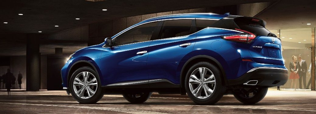 Rear driver angle of a blue 2020 Nissan Murano