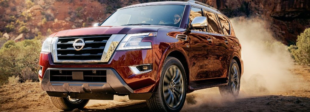 Front driver angle of a red 2021 Nissan Armada