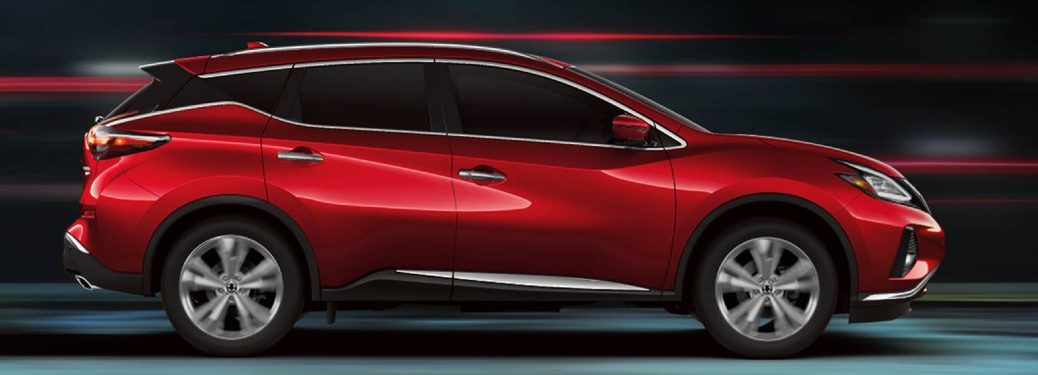 Passenger angle of a red 2020 Nissan Murano on a blurry background