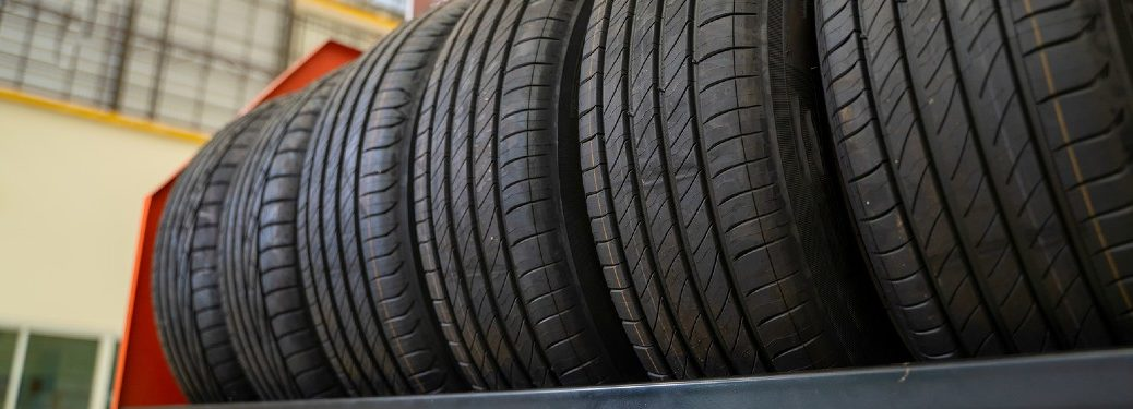 Tires sitting on a shelf at an auto shop