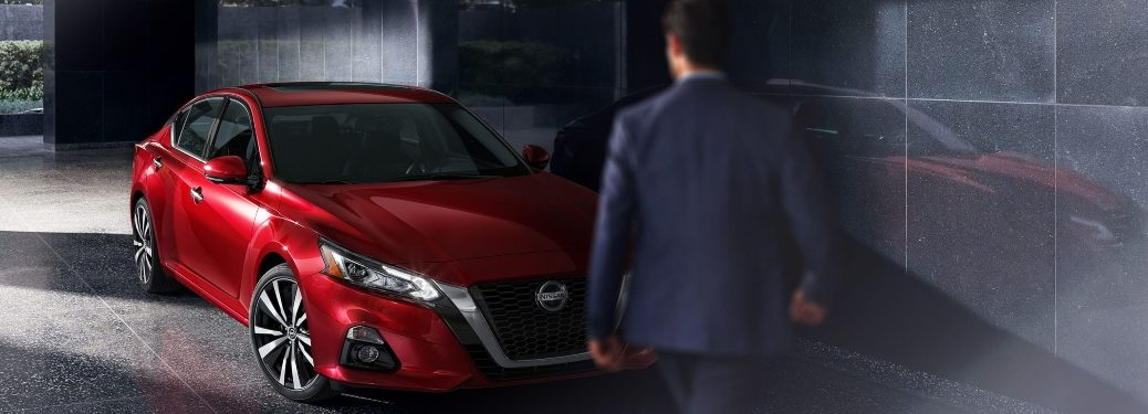 2020 Nissan Altima red front view with man walking toward it