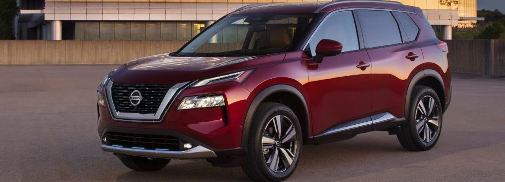 Front driver angle of a red 2021 Nissan Rogue