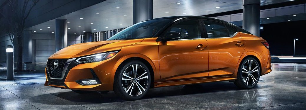 Front driver angle of an orange 2021 Nissan Sentra