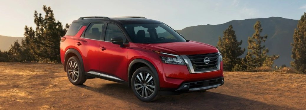 Front passenger angle of a red 2022 Nissan Pathfinder