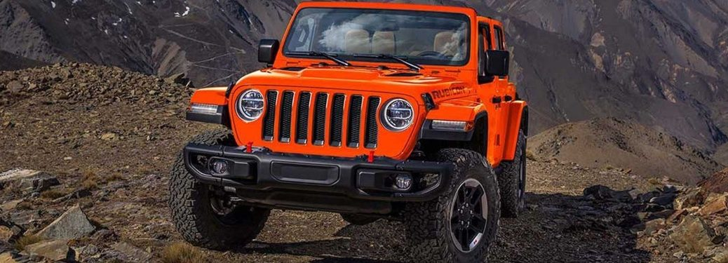 Front view of an orange 2019 Jeep Wrangler