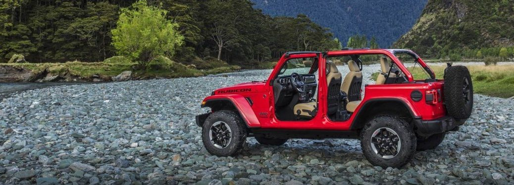 Red 2019 Jeep Wrangler parked in the mountains