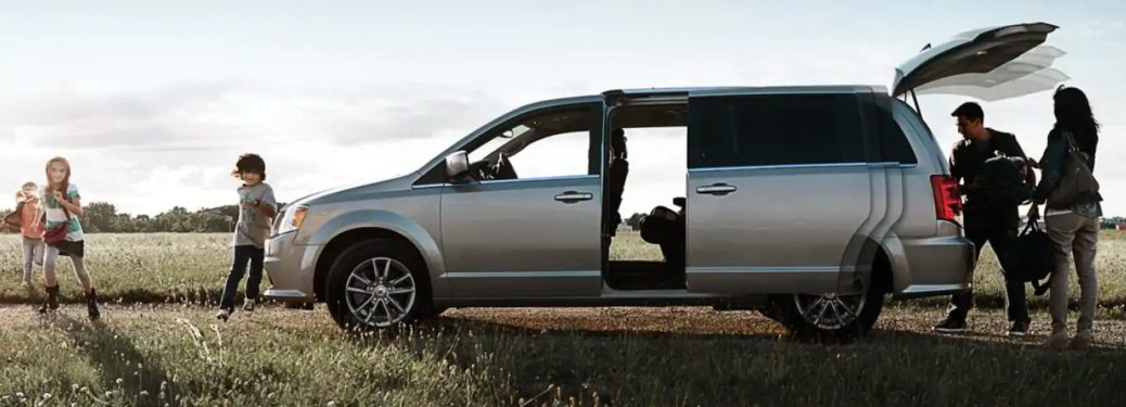 Family unloading the 2019 Dodge Grand Caravan