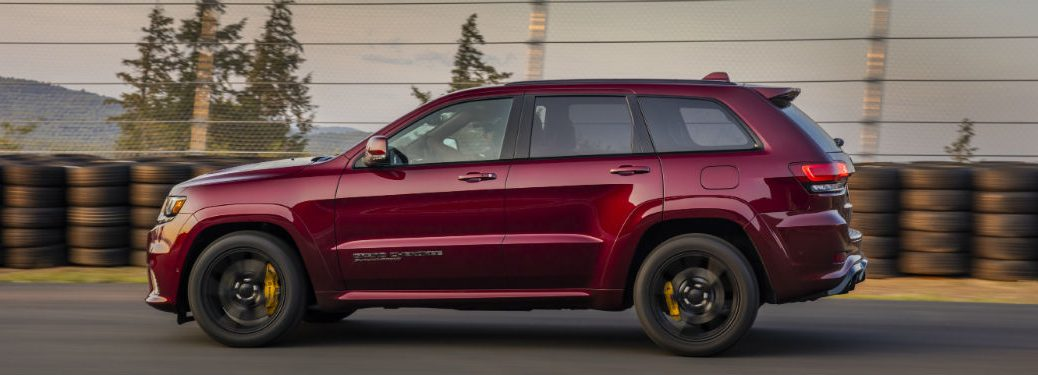 side view of a red 2020 Jeep Grand Cherokee