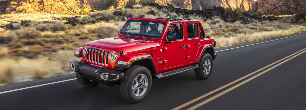 side view of a red 2020 Jeep Wrangler