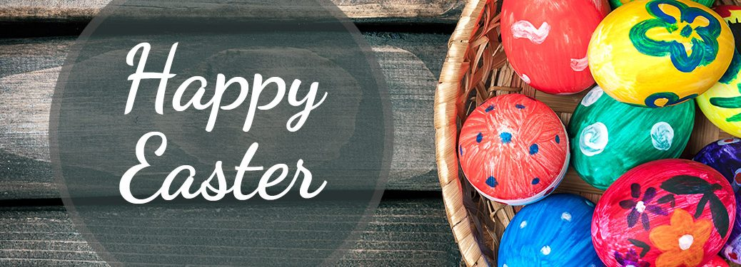 happy Easter written next to a basket of eggs