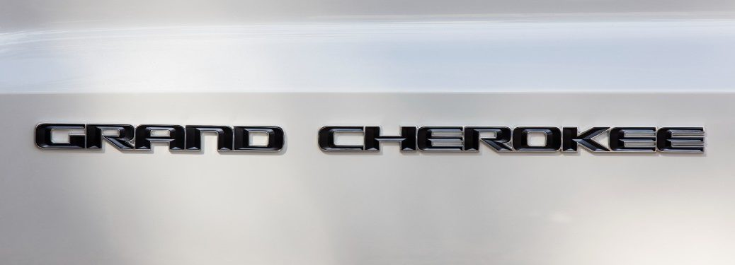 badge on a silver 2021 Jeep Grand Cherokee