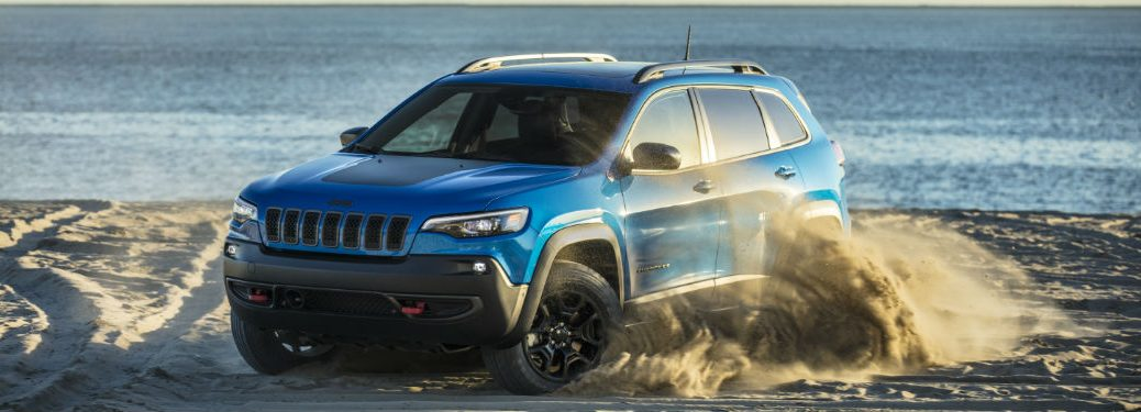 side view of a blue 2021 Jeep Cherokee