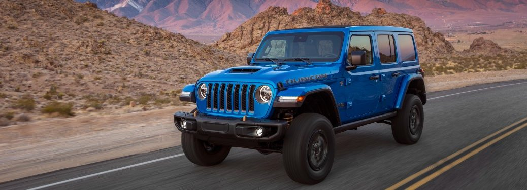 side view of a blue 2021 Jeep Wrangler Rubicon 392