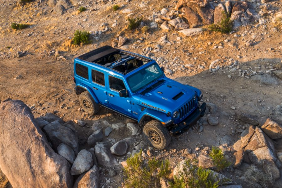 high angle side view of a blue 2021 Jeep Wrangler Rubicon 392