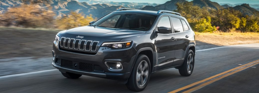 jeep cherokee driving on a mountain road