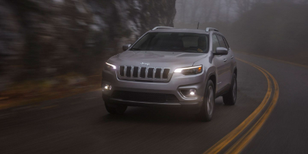 led daytime running lights cutting through fog on a jeep cherokee