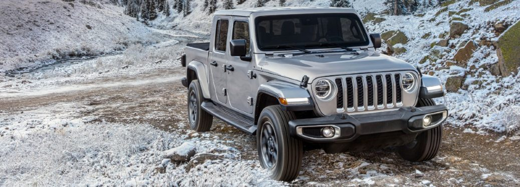 silver jeep wrangler on a snow hill