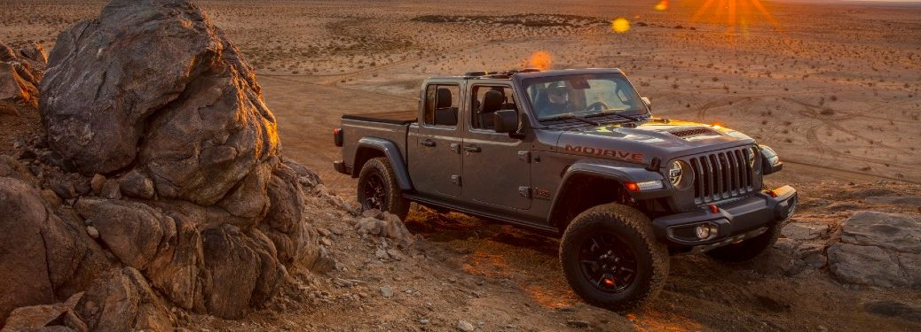 Jeep gladiator climbing a hill