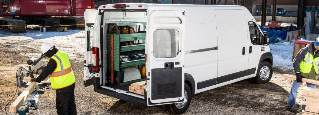 people working around a ram promaster