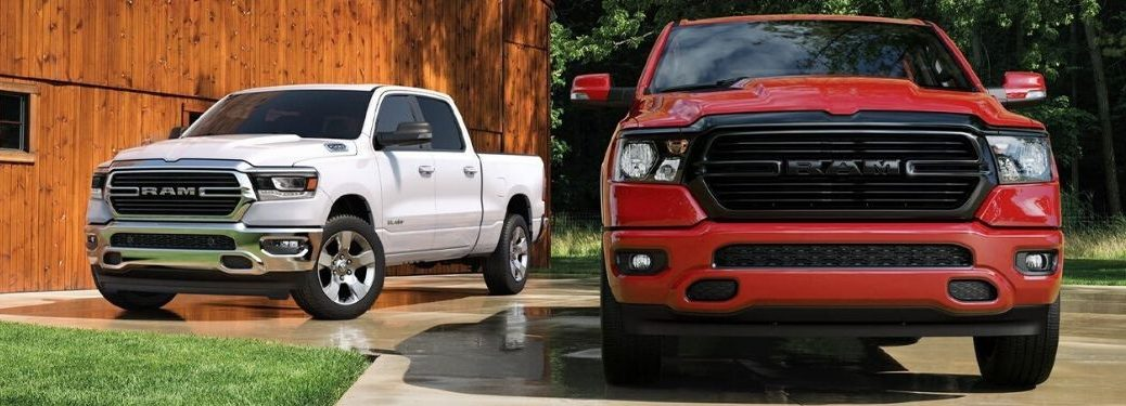 White and Red 2020 Ram 1500 Models in a Driveway