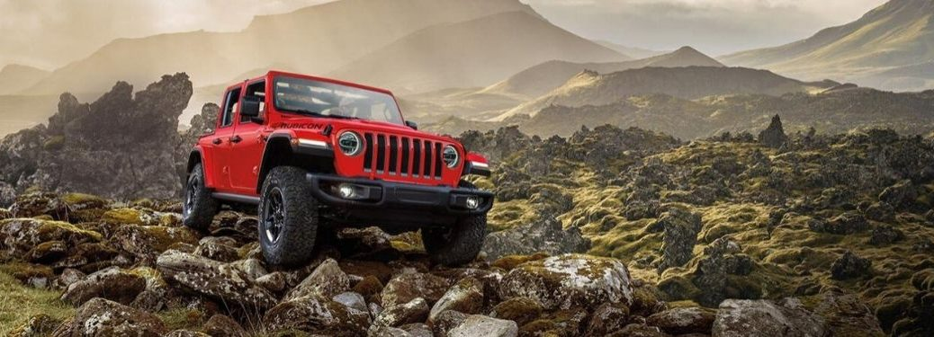 Red 2020 Jeep Wrangler on a Rocky Mountainside