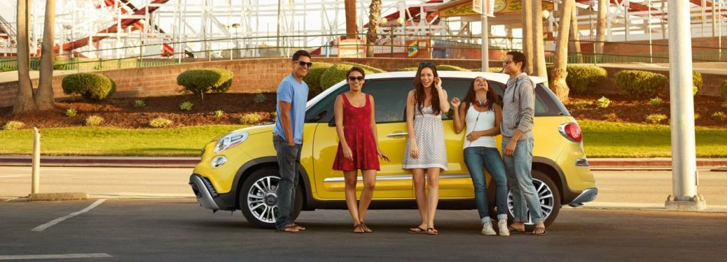 2018 FIAT 500L yellow side view with people