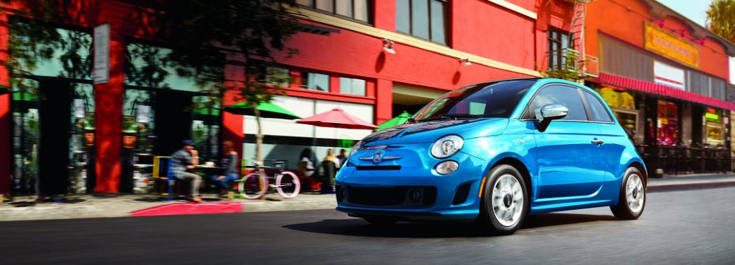 Blue 2018 Fiat 500 driving down the street