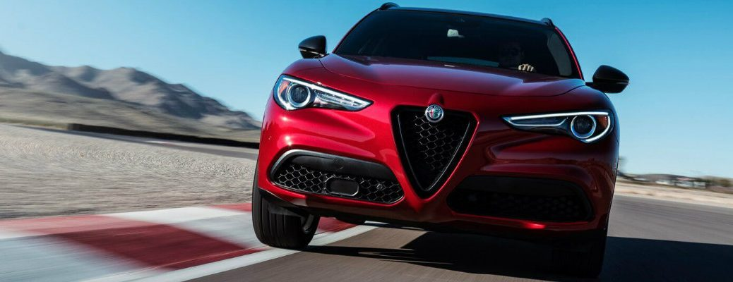 Front view of red 2018 Alfa Romeo Stelvio on track