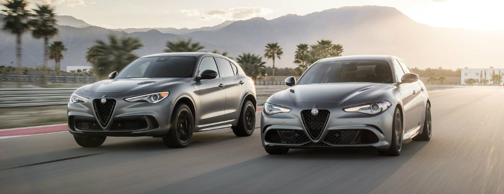 2019 Alfa Romeo Stelvio Quadrifoglio NRING and 2019 Alfa Romeo Giulia Quadrifoglio NRING models driving side by side on a racetrack