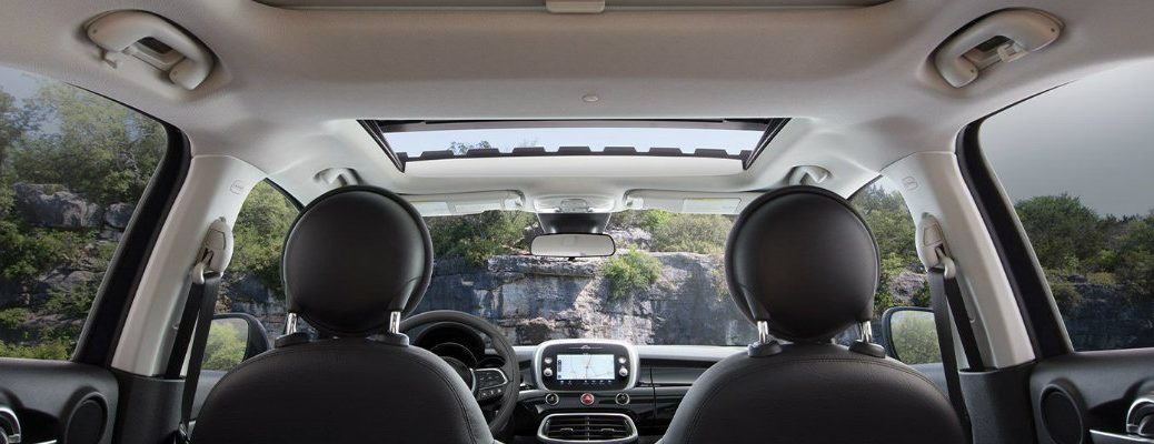 2019 Fiat 500X Blue Sky Edition interior shot view from back row seating showing seating, dashboard, and sunroof