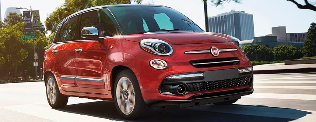 Red 2019 Fiat 500L driving on city road