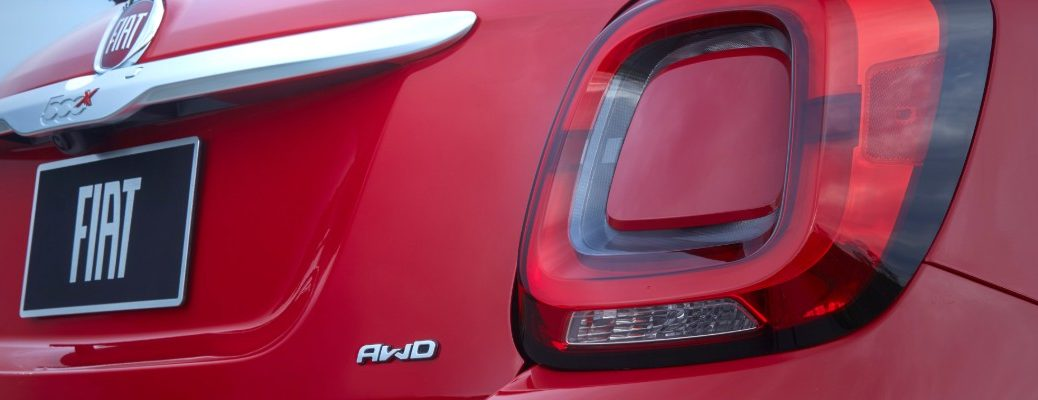 2020 Fiat 500X exterior closeup of back end license plate, model badging, AWD badge, and taillight lamp design