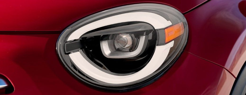 2020 Fiat 500X Sport exterior closeup shot of headlight design on front end of the crossover model with red rosso paint color
