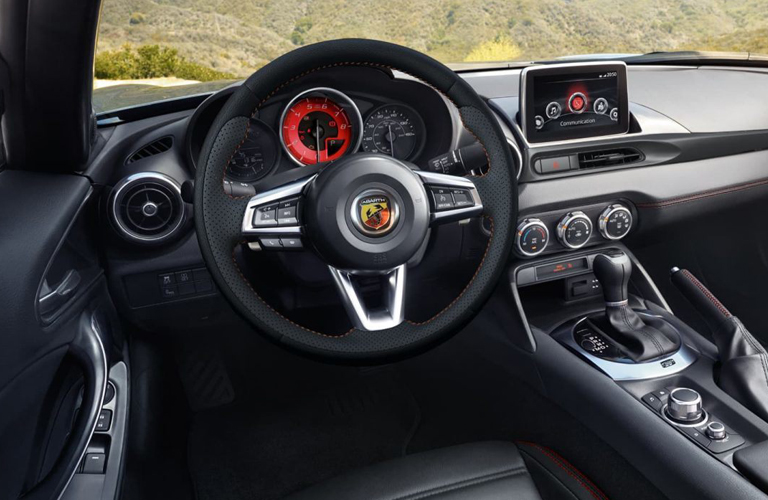 Steering wheel and center touchscreen inside Fiat 124 Spider