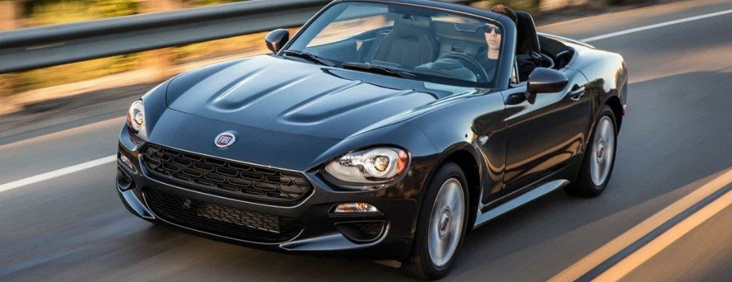 2020 Fiat 124 Spider exterior overhead shot with black gray paint color as it drives down a country highway