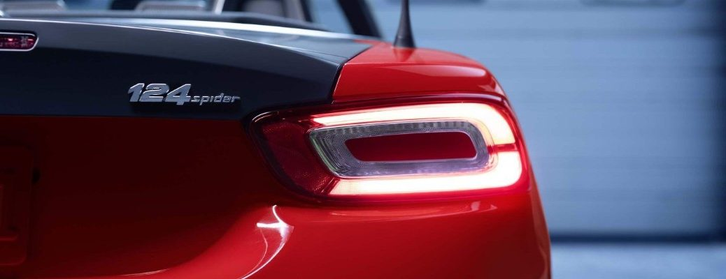 2020 Fiat 124 Spider exterior closeup shot of rear bumper, taillight design, antenna, and model badge