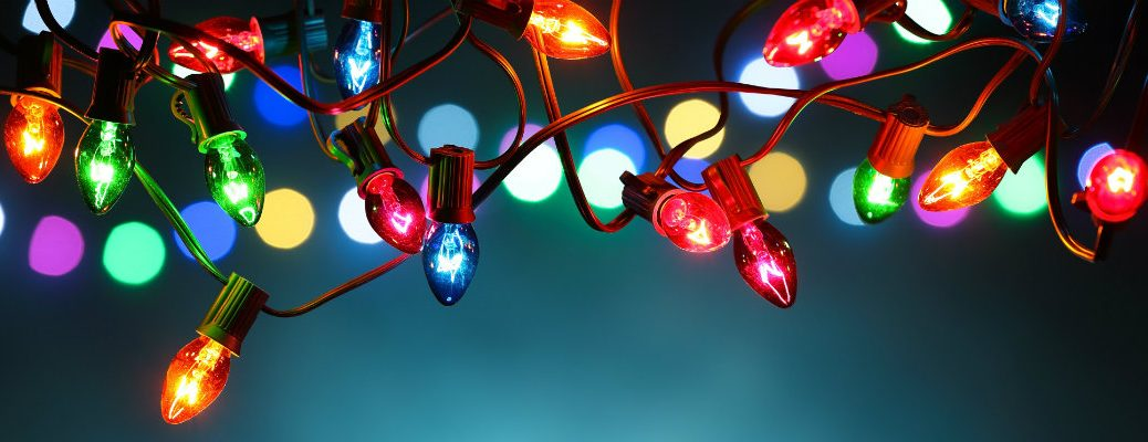 a bundle of colorful Christmas light hanging overhead and shining brightly