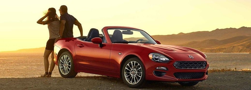 2020 Fiat 124 Spider parked by beach with couple standing at rear