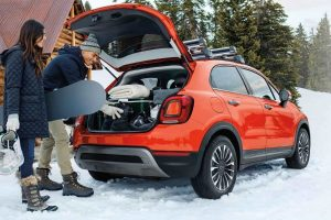 People loading supplies into the trunk of 2020 Fiat 500X Trekking Plus
