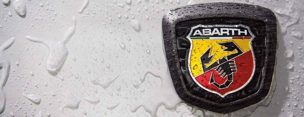 2020 Fiat 124 Spider Abarth exterior closeup of Abarth badge on Brillante White paint color