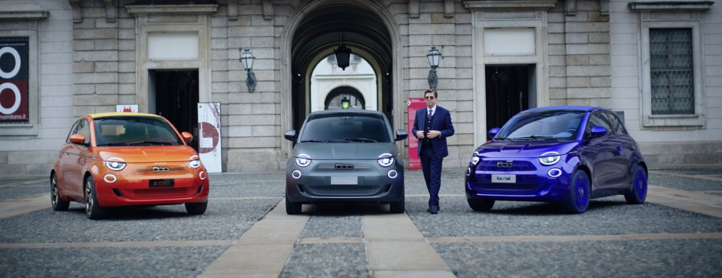 Fiat 500 Special Editions from Armani, BVLGARI, and Kartell parked outside a stone building for a presentation in the One-Shot documentary film