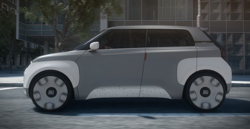 Fiat Concept Centoventi exterior side shot with white and gray coloring driving in an urban city setting