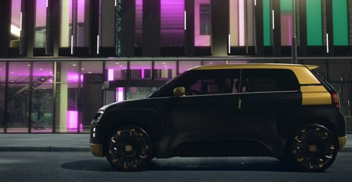 Fiat Concept Centoventi exterior side shot with black and gold coloring parked outside a building at night