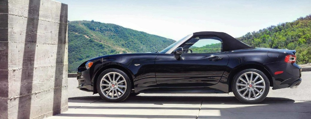 The side view of a black 2020 Fiat 124 Spider.