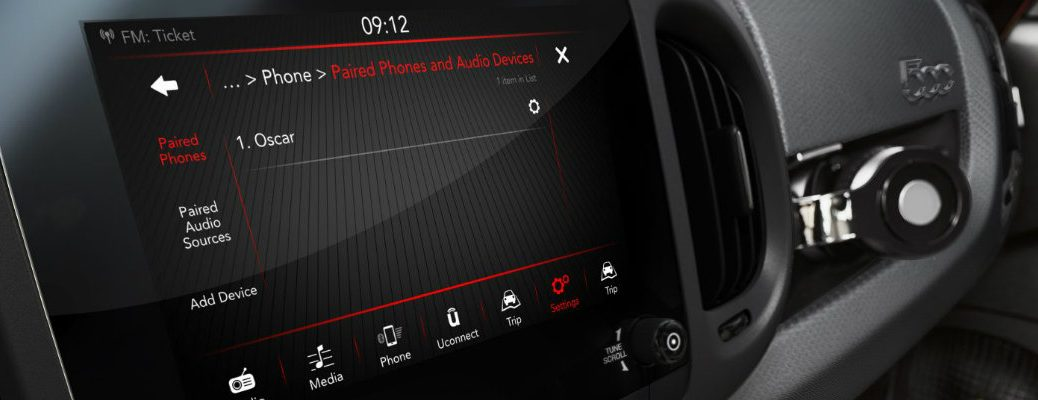 Isolated view of Fiat Uconnect infotainment system with phone paired