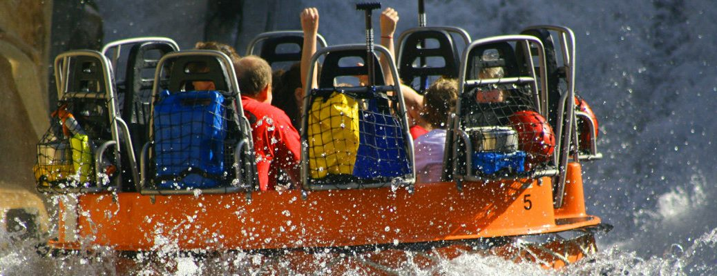 Young people having fun on waterpark ride